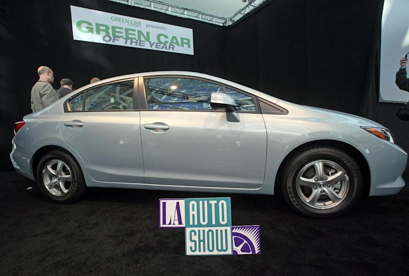 FILE - In this Nov. 17, 2011 file photo, the 2012 Honda Civic Natural Gas car, named Green Car of the Year for 2012, is displayed after its unveiling at press preview day for the Los Angeles Auto Show. Fill 'er up _ with natural gas. High pump prices are encouraging GM and Chrysler to roll out pickups that run on natural gas, which is plentiful and cheap in the U.S..  Here's a look at what models are coming, what's already out there and where to go to fill up. (AP Photo/Reed Saxon, File)