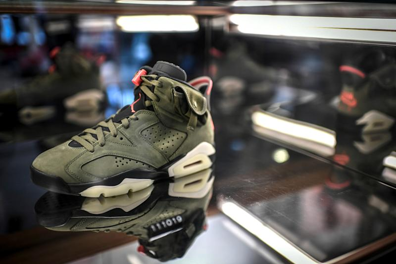A limited edition of the Travis Scott x Air Jordan 6 sneaker is displayed in a shop as part of the 'raffles' on October 8, 2019 in Paris. (Photo by STEPHANE DE SAKUTIN / AFP) (Photo by STEPHANE DE SAKUTIN/AFP via Getty Images)