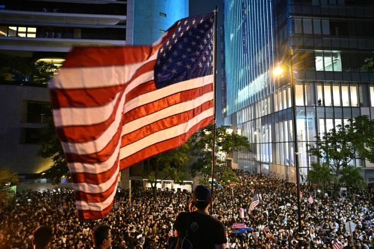 Tens of thousands rallied in Hong Kong on Monday, calling on Washington to punish Beijing over sliding freedoms in the semi-autonomous city