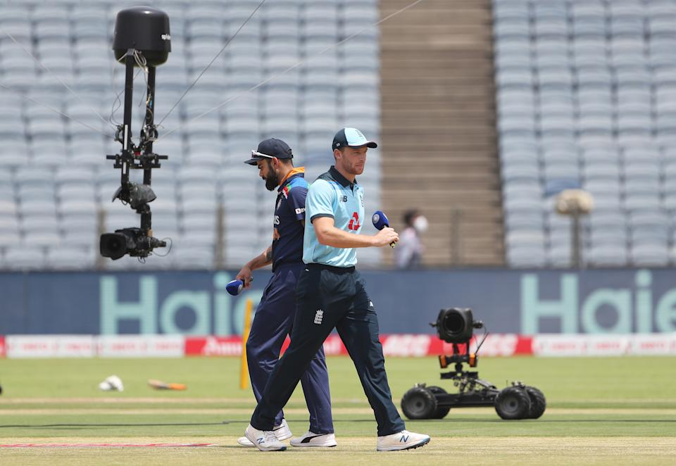 England captain Jos Buttler and India captain Virat Kohli at the toss ahead of the 2nd One Day International between India and England at MCA Stadium on March 26, 2021 in Pune, India. (Photo by Surjeet Yadav/Getty Images)