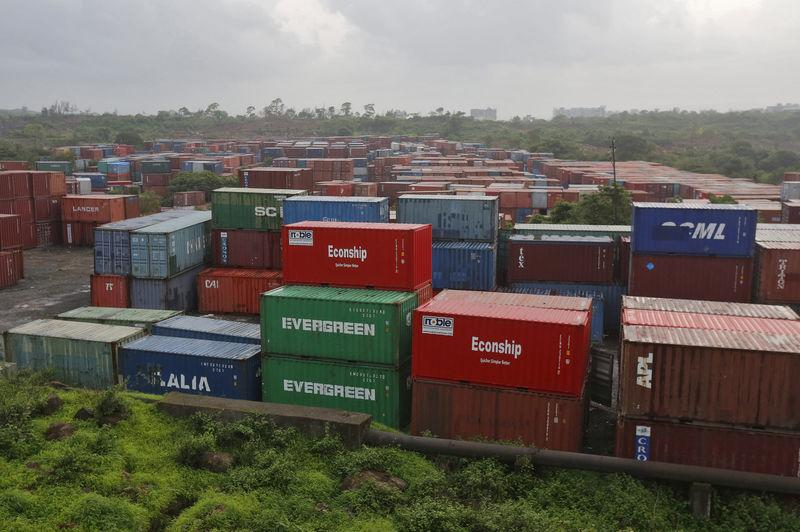Cargo containers are seen stacked outside the container terminal of JNPT in Mumbai