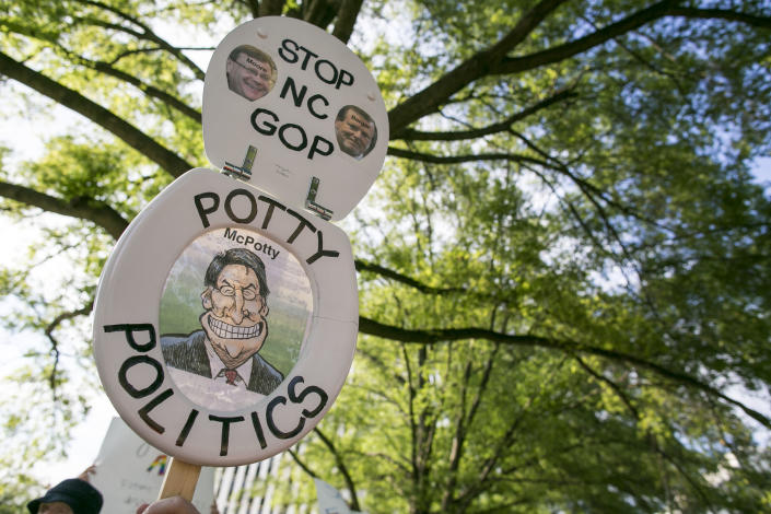 Protesters in May 2016 gather across the street from the North Carolina state legislative building in Raleigh to voice their concerns over House Bill 2. (Photo: Al Drago/CQ Roll Call)
