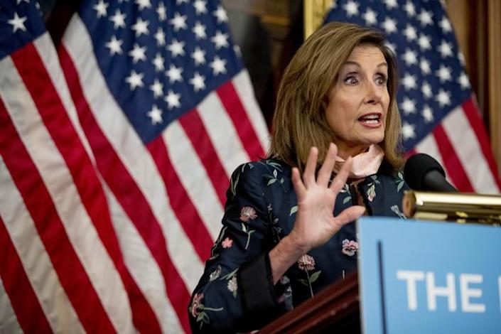 """House Speaker Nancy Pelosi of Calif. speaks at a news conference on Capitol Hill in Washington, Wednesday, July 15, 2020, to mark two months since House passage of """"The Heroes Act"""" or the Health and Economic Recovery Omnibus Emergency Solutions Act. (AP Photo/Andrew Harnik)"""