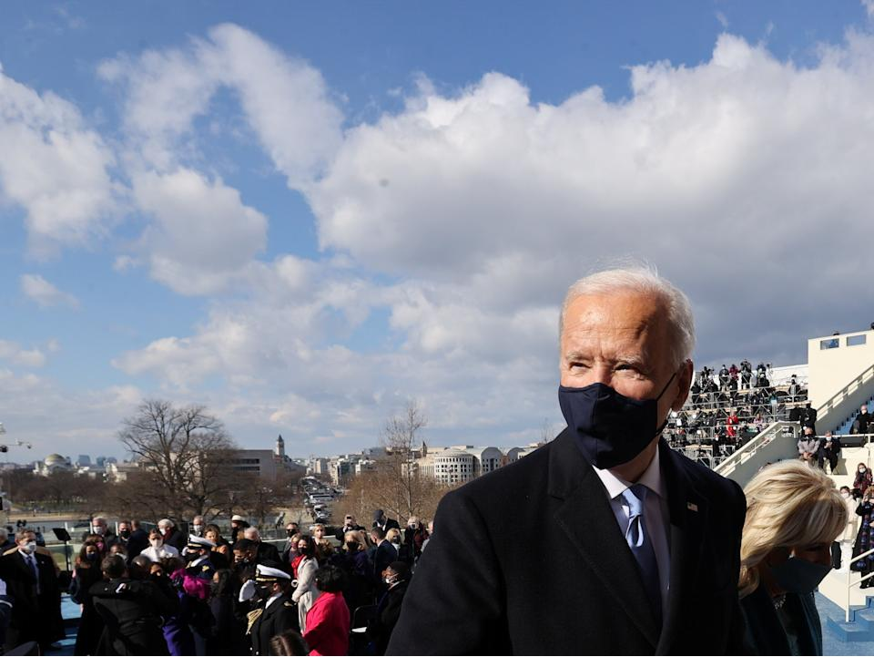 <p>President Joe Biden and the first lady Dr Jill Biden leave Wednesday's inauguration ceremony at the US Capitol in Washington</p> (Reuters)