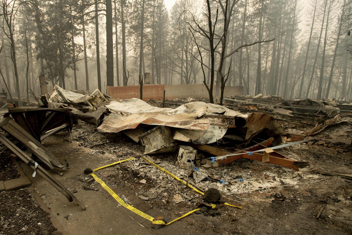 <p>Tape marks a spot where sheriff's deputies recovered the body of a Camp Fire victim on Wednesday, Nov. 14, 2018, in Paradise, Calif. Thousands of homes were destroyed when flames hit Paradise, a former gold-mining camp popular with retirees, on Nov. 8, killing multiple people in California's deadliest wildfire. (Photo: Noah Berger/AP) </p>