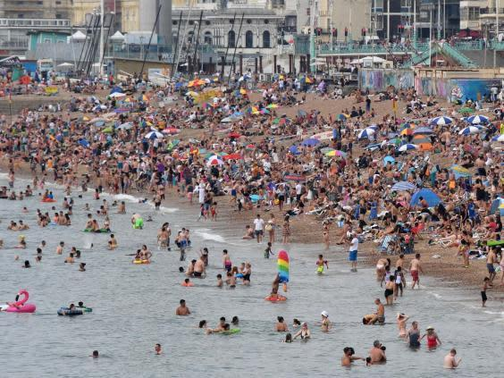 Brighton beach is packed as the south of England basks in a summer heatwave (Images)