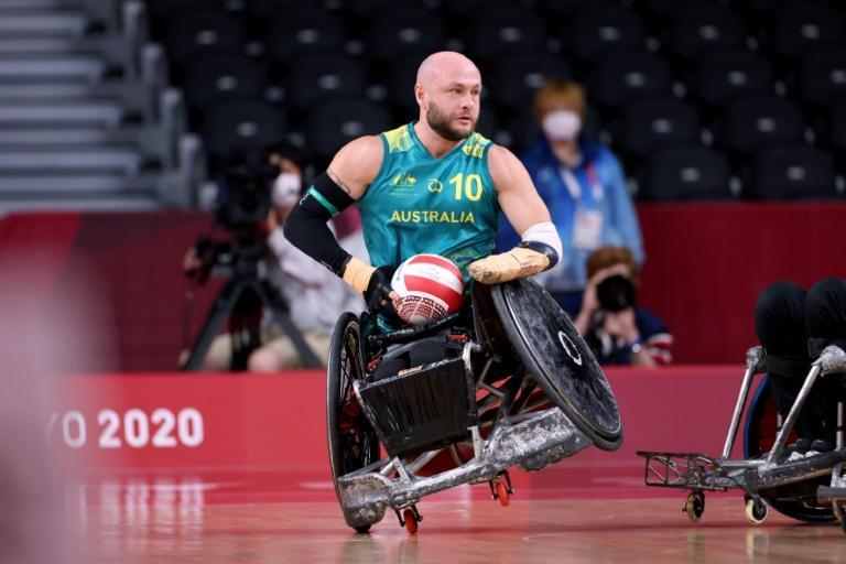 Australia's Chris Bond grabs the ball during the pool phase group A wheelchair rugby match against Denmark (AFP/Behrouz MEHRI)