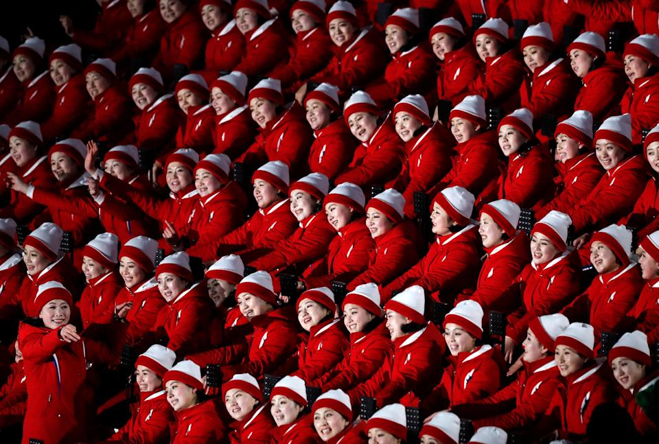 Cheerleaders of North Korea await the start of the Opening Ceremony of the 2018 Winter Olympics. (Reuters)