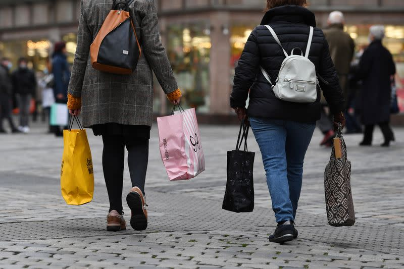 Women with shopping bags walk through the city center in Nuremberg