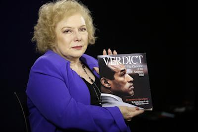 In this Tuesday, June 3, 2014 photo, Associated Press reporter Linda Deutsch poses for a photo with her book Verdict, The Chronicle of the O.J. Simpson Trial in Los Angeles. (Damian Dovarganes/AP)