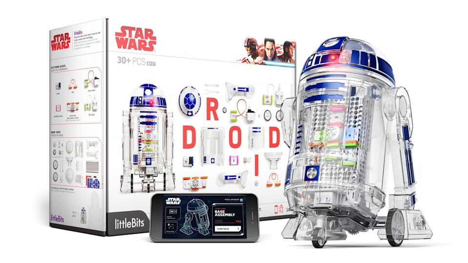 """<p>Kids get to play Jedi with a <a href=""""https://www.popsugar.com/buy/Droid-Inventor-Kit-396666?p_name=Droid%20Inventor%20Kit&retailer=amazon.com&pid=396666&price=59&evar1=moms%3Aus&evar9=32519221&evar98=https%3A%2F%2Fwww.popsugar.com%2Ffamily%2Fphoto-gallery%2F32519221%2Fimage%2F43976712%2FDroid-Inventor-Kit&list1=gifts%2Choliday%2Cgift%20guide%2Cstar%20wars%2Cparenting%2Cgifts%20for%20kids%2Ckid%20shopping%2Ctweens%20and%20teens%2Cgifts%20for%20teens&prop13=api&pdata=1"""" class=""""link rapid-noclick-resp"""" rel=""""nofollow noopener"""" target=""""_blank"""" data-ylk=""""slk:Droid Inventor Kit"""">Droid Inventor Kit</a> ($59, originally $100) that allows them to guide R2-D2 with their hands once they're all done building him from electronic blocks.</p>"""