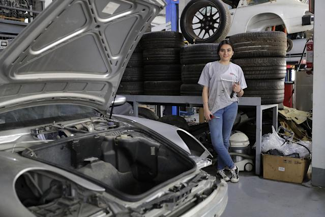 <p>Lebanese mechanic Rana el-Hayek, 22, poses in a car repair garage where she works in Qannabat Brummana, northeast of Beirut, on March 3, 2018. (Photo: Joseph Eid/AFP/Getty Images) </p>