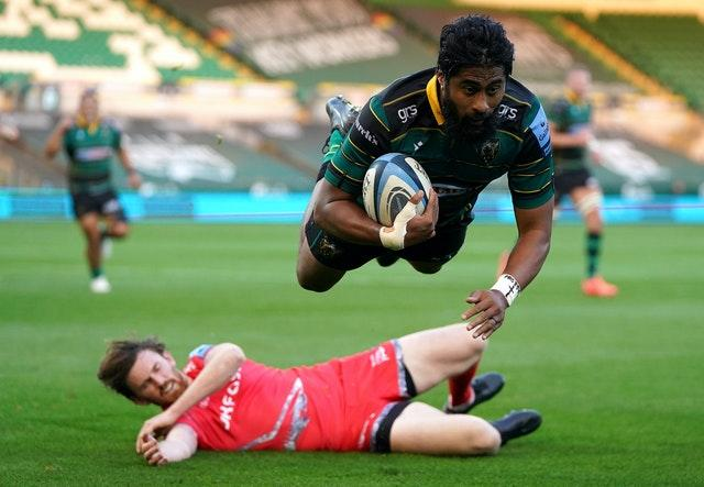 Ahsee Tuala dives over for Northampton's first try