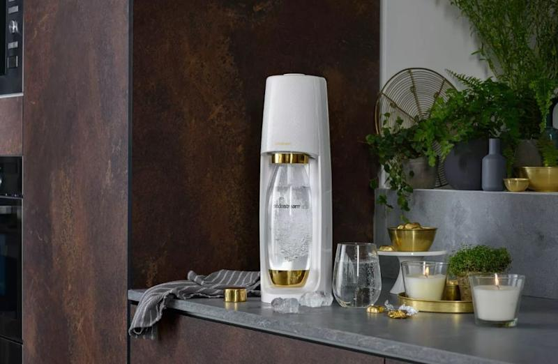 "This little cordless machine from Fizzi turns tab water into sparkling water.&nbsp;It's designed to be space-saving so it doesn't take up an entire countertop. Plus, it has gold accents and won't look out-of-place anywhere you put it in. <strong><a href=""https://fave.co/2qdGdUX"" target=""_blank"" rel=""noopener noreferrer"">Originally $90, you can get it for $50 at Target.</a></strong>."