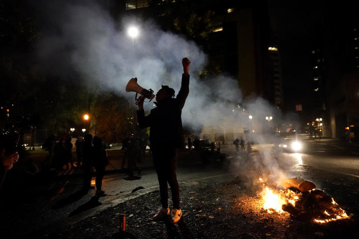 A protester yells after a march to the Mark O. Hatfield United States Courthouse on the night of the election, Tuesday, Nov. 3, 2020, in Portland, Ore. (AP Photo/Marcio Jose Sanchez)