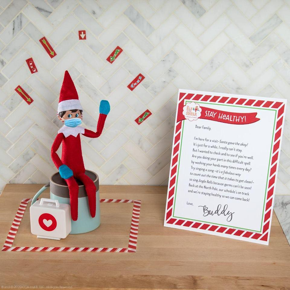 """<p>This has not been a typical year, and your kids may be curious about what quarantine life was like at the North Pole! Write up a short note explaining that Santa and his helpers are safe and healthy. Oh, and of course your Elf needs a mask!</p><p><strong>Get the tutorial at <a href=""""https://www.elfontheshelf.com/elf-ideas/quarantine-letter"""" rel=""""nofollow noopener"""" target=""""_blank"""" data-ylk=""""slk:The Elf on the Shelf"""" class=""""link rapid-noclick-resp"""">The Elf on the Shelf</a>.</strong></p><p><strong><a class=""""link rapid-noclick-resp"""" href=""""https://go.redirectingat.com?id=74968X1596630&url=https%3A%2F%2Fwww.etsy.com%2Flisting%2F876989243%2Felf-on-the-shelf-size-covid-masks&sref=https%3A%2F%2Fwww.countryliving.com%2Flife%2Fkids-pets%2Fg29656008%2Felf-on-the-shelf-return-ideas%2F"""" rel=""""nofollow noopener"""" target=""""_blank"""" data-ylk=""""slk:Shop Elf Masks"""">Shop Elf Masks</a><br></strong></p>"""