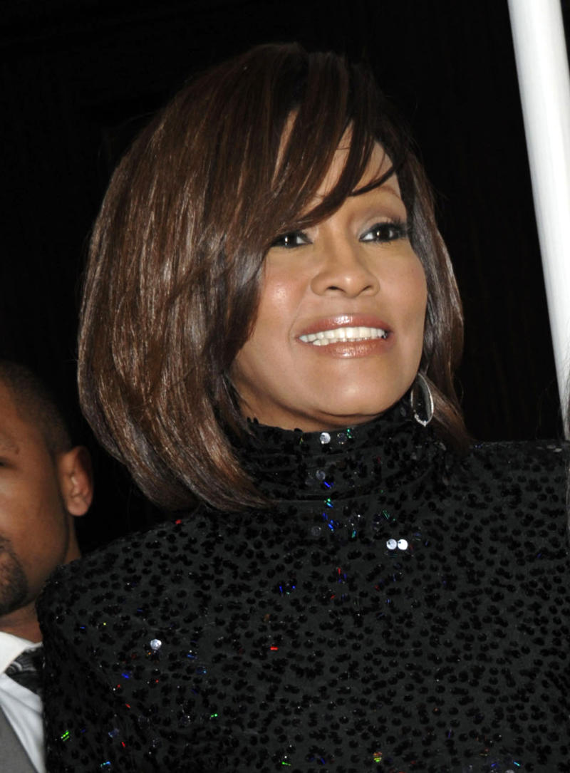 FILE - In this Feb. 12, 2011 file photo, singer Whitney Houston, left, and her daughter Bobbi Kristina arrive at the Pre-Grammy Gala & Salute to Industry Icons with Clive Davis honoring David Geffen in Beverly Hills, Calif. Coroner's officials said Thursday, March 22, 2012, that Houston drowned, but her death was also caused by heart disease and cocaine use that suggested she was chronically using the drug. Houston died Feb. 11, in California at the age of 48. (AP Photo/Dan Steinberg, file)