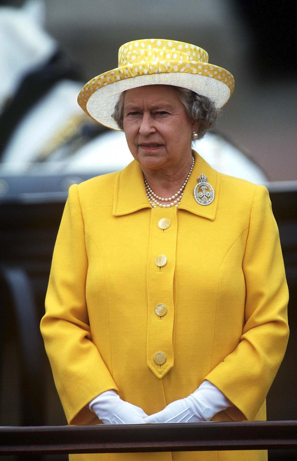 For the 1999 celebrations, Her Majesty opted for a bright yellow number and co-ordinating hat. (Rex pictures)