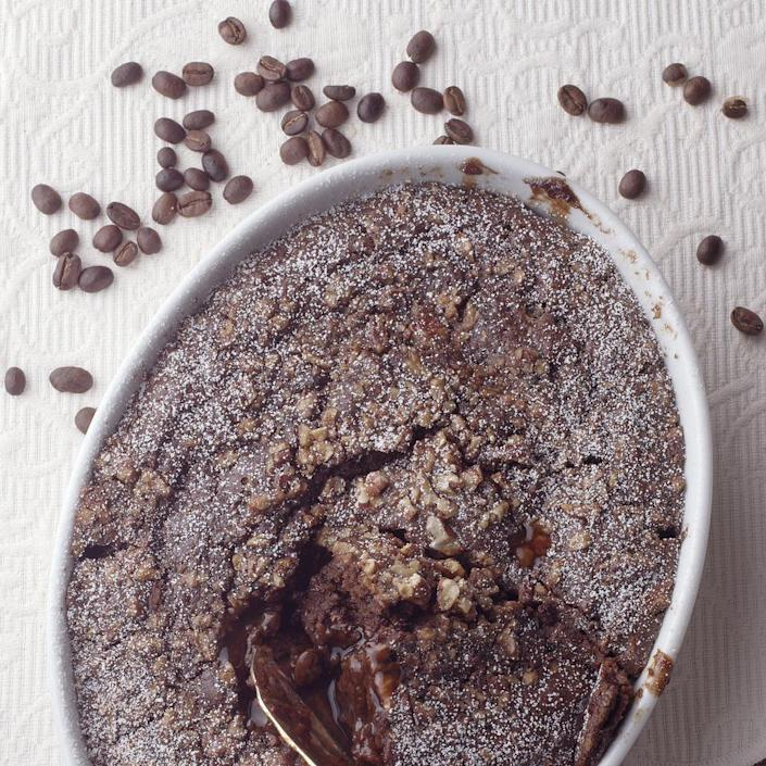 <p>When you have a craving for a comforting dessert, try this pudding cake, which forms its own rich-tasting sauce as it bakes. The coffee flavor is subtle, but it adds complex depth to the cake's flavor.</p>
