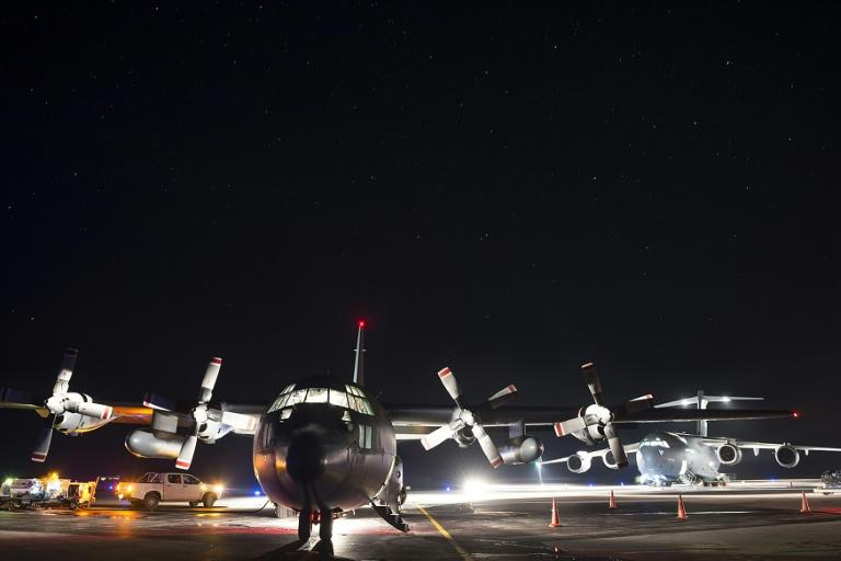A New Zealand military transport plane delivering aid and supplies to Tonga in the wake of Cyclone Gita