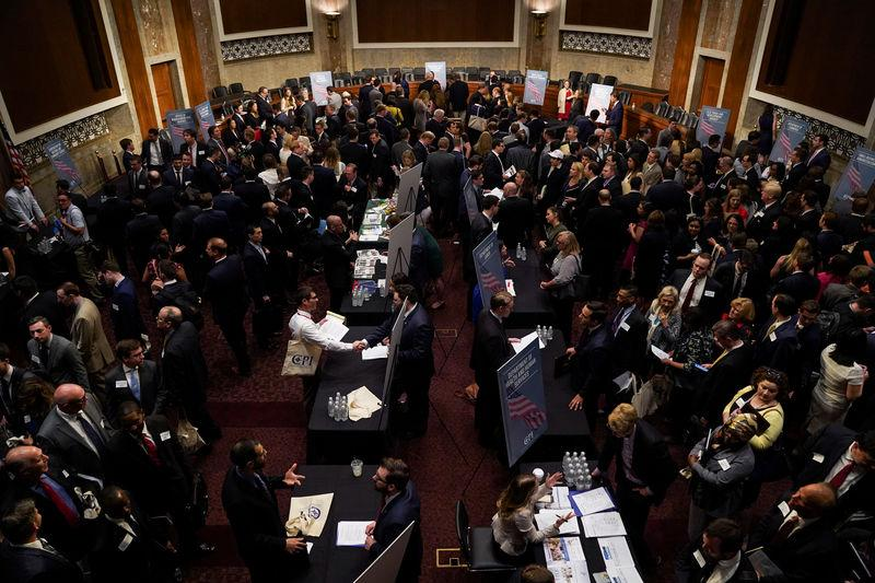 FILE PHOTO: People attend the Executive Branch Job Fair hosted by the Conservative Partnership Institute at the Dirksen Senate Office Building in Washington