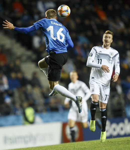 Estonia's Joonas Tamm, left, fights for the ball with Germany's Marco Reus during the Euro 2020 group C qualifying soccer match between Estonia and Germany at the A. Le Coq Arena in Tallinn, Estonia, Sunday, Oct. 13, 2019. (AP Photo/Raul Mee)