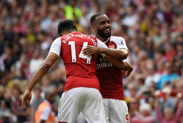 """Soccer Football - Premier League - Arsenal v West Ham United - Emirates Stadium, London, Britain - April 22, 2018 Arsenal's Alexandre Lacazette celebrates with Pierre-Emerick Aubameyang after scoring their fourth goal Action Images via Reuters/Tony O'Brien EDITORIAL USE ONLY. No use with unauthorized audio, video, data, fixture lists, club/league logos or """"live"""" services. Online in-match use limited to 75 images, no video emulation. No use in betting, games or single club/league/player publications. Please contact your account representative for further details."""