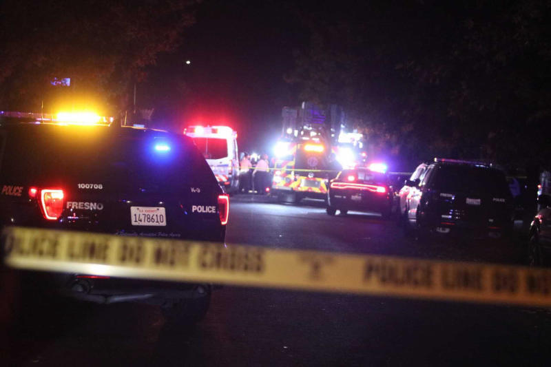 Police and emergency vehicles work at the scene of a shooting at a backyard party, Sunday, Nov. 17, 2019, in southeast Fresno, Calif. (Photo: Larry Valenzuela/The Fresno Bee via AP)