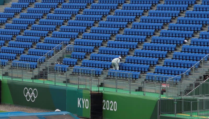 A worker inspects seats at Tokyo2020 Olympic BMX Track in preparation for the Tokyo 2020 Olympic Games in Tokyo