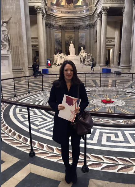 Britain's Catherine Norris Trent holds her document after a naturalization ceremony in Paris' Pantheon monument, Thursday, March 21, 2019. With the looming Brexit deadline, the 38-year-old mother of two who's lived in the French capital for over a decade was one of dozens of newly-minted French nationals attending the ceremony. (AP Photo/Thomas Admason)