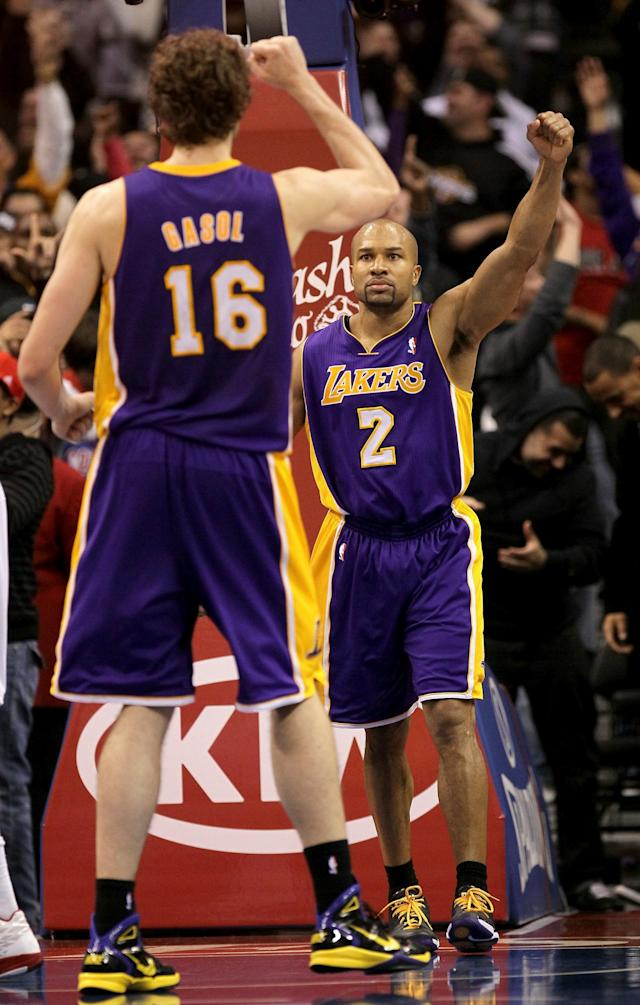 LOS ANGELES, CA - DECEMBER 8: Derek Fisher #2 and Pau Gasol #7 of the Los Angeles Lakers celebrate after Fisher's shot at the buzzer put the Lakers ahead for the victory against the Los Angeles Clippers at Staples Center on December 8, 2010 in Los Angeles, California. The Lakers won 87-86. NOTE TO USER: User expressly acknowledges and agrees that, by downloading and or using this photograph, User is consenting to the terms and conditions of the Getty Images License Agreement. (Photo by Stephen Dunn/Getty Images)
