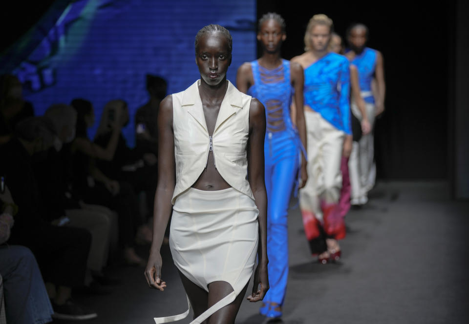 Models wear creations for the Drome Spring Summer 2022 collection during Milan Fashion Week, in Milan, Italy, Thursday, Sept. 23, 2021. (AP Photo/Antonio Calanni)