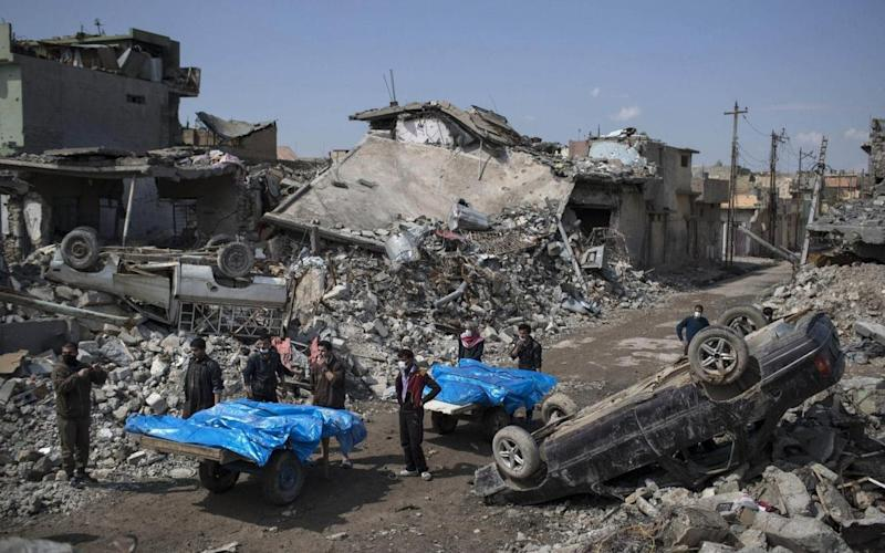 Men, women and children were pulled from the rubble in the latest strike - AP