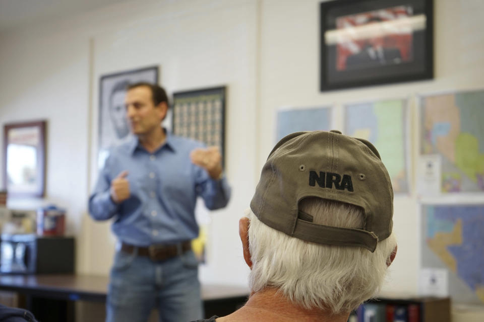 In this Sunday, Oct. 10, 2021, photo Republicans listen as Senate candidate Adam Laxalt speaks at the Douglas County Republican Party Headquarters on the final day of his Senate campaign's statewide tour in Gardnerville, Nev. Republican Laxalt hopes to win the race for Nevada's U.S. Senate seat by drawing stark between his positions and the direction he says Democrats and their allies in Big Tech, Hollywood and the media are taking the country. (AP Photo/Sam Metz)