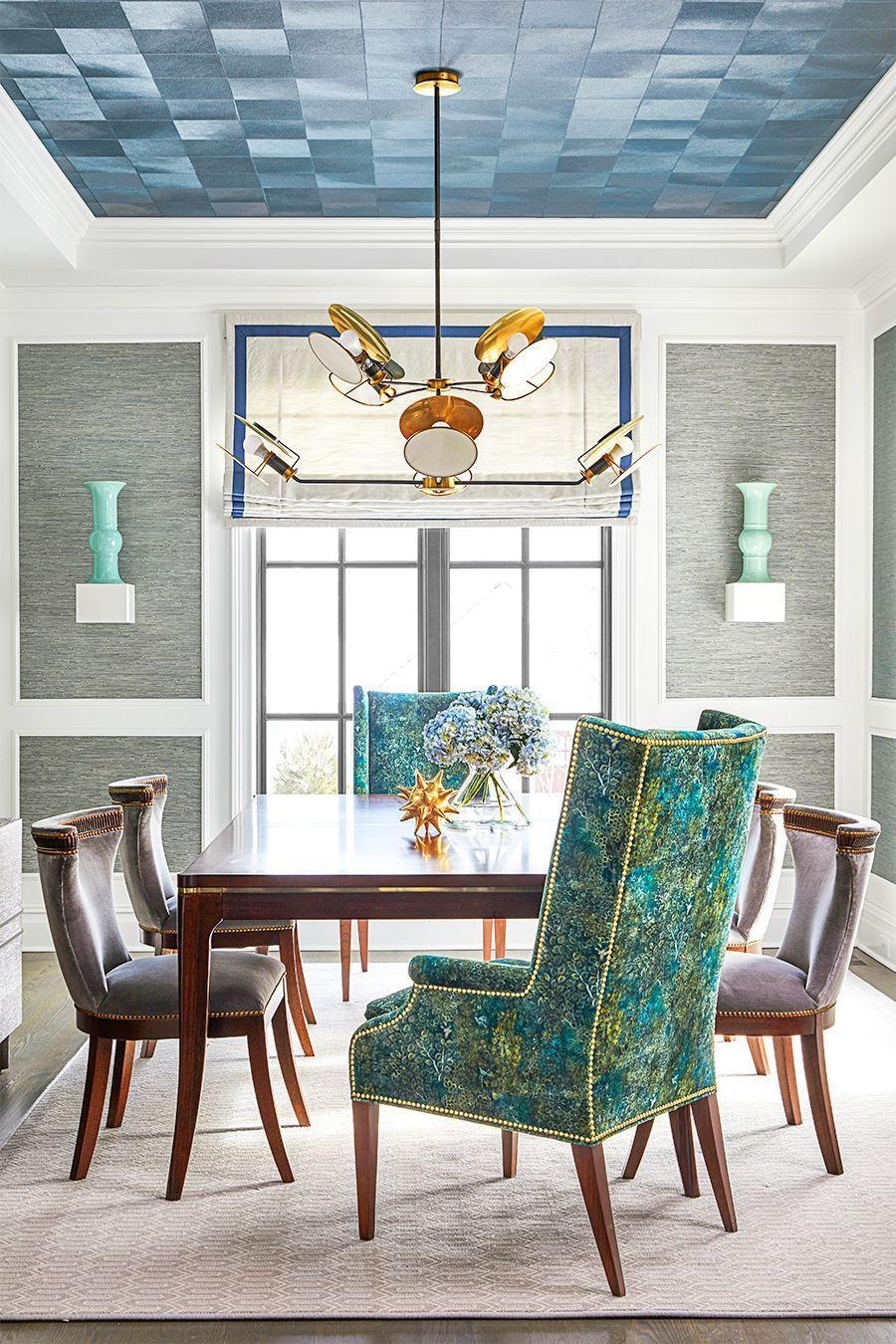 """<p>Two floating cubic shelves function as pedestals to prop up vases in this colorful dining room designed by <a href=""""https://coreydamenjenkins.com/"""" rel=""""nofollow noopener"""" target=""""_blank"""" data-ylk=""""slk:Corey Damen Jenkins"""" class=""""link rapid-noclick-resp"""">Corey Damen Jenkins</a>. This trick is perfect for a narrow wall in a dining room, hallway, or entry. </p>"""
