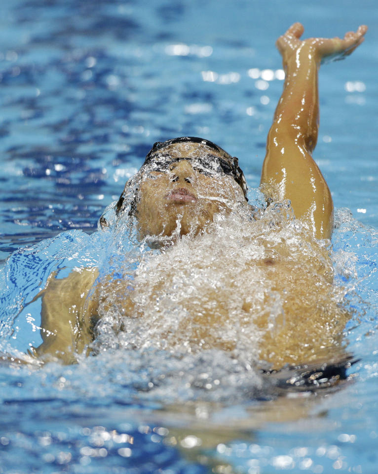 Japan's Kosuke Hagino competes in a heat of the men's 400-meter individual medley at the 2012 Summer Olympics, in London, Saturday, July 28, 2012. (AP Photo/Michael Sohn)