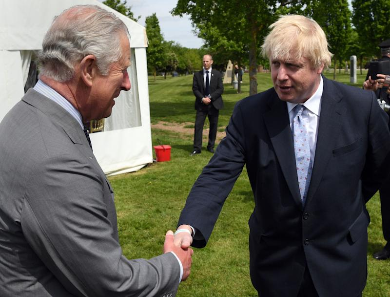 Britain's Prince Charles, Prince of Wales chats to Britain's Foreign Secretary Boris Johnson (R) following the dedication service for the National Memorial to British Victims of Overseas Terrorism at the National Memorial Arboretum in Alrewas, Staffordshire on May 17, 2018. (Photo by Paul ELLIS / various sources / AFP) (Photo credit should read PAUL ELLIS/AFP via Getty Images)