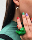 """Red, green, and something in between—make it purple for an unexpected twist. Try Essie polishes in <a href=""""https://shop-links.co/1724788082109207751"""" rel=""""nofollow noopener"""" target=""""_blank"""" data-ylk=""""slk:Heart of The Jungle"""" class=""""link rapid-noclick-resp"""">Heart of The Jungle</a>, <a href=""""https://shop-links.co/1724788106824792916"""" rel=""""nofollow noopener"""" target=""""_blank"""" data-ylk=""""slk:Adrenaline Brush"""" class=""""link rapid-noclick-resp"""">Adrenaline Brush</a>, and <a href=""""https://shop-links.co/1724788166325724855"""" rel=""""nofollow noopener"""" target=""""_blank"""" data-ylk=""""slk:Flowerista"""" class=""""link rapid-noclick-resp"""">Flowerista</a> for a similar vibe."""