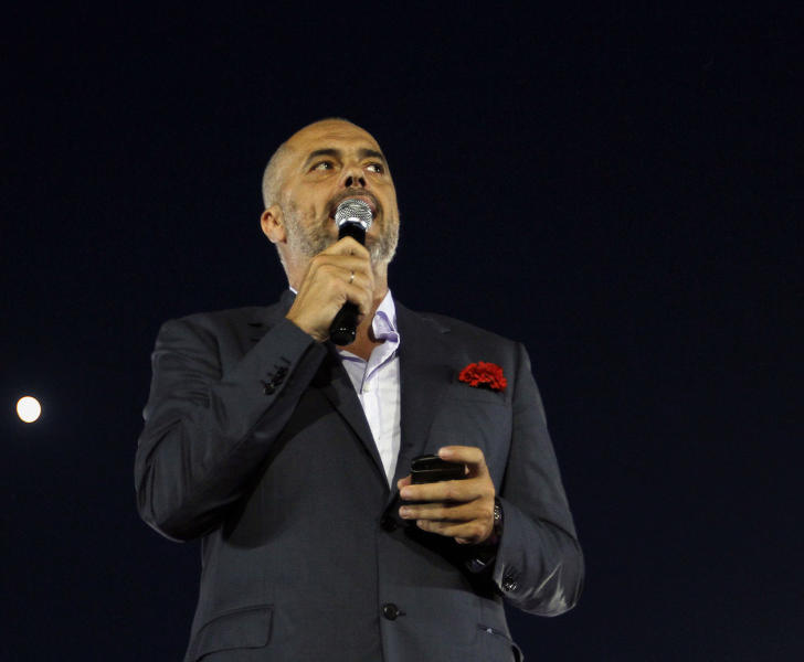 In this Thursday, June 20, 2013 photo, main opposition Socialist Party leader Edi Rama, speaks at a rally, in Tirana, Albania, ahead of the Sunday's general elections. Political parties in Albania entered their final day of campaigning for Sunday's general elections, considered a test for the Balkan country to shed its history of troubled campaigns as it seeks closer ties and eventual membership in the European Union. (AP Photo/Hektor Pustina)