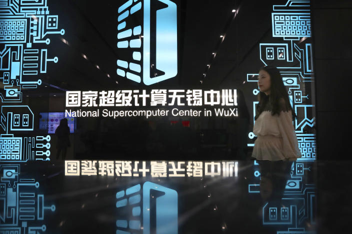 A woman walks in the hallway of the National Supercomputer Center in Wuxi, which hosts the Shenwei (Sunway) TaihuLight supercomputer, in Wuxi in eastern China's Jiangsu province on Aug. 29, 2020. The Biden administration has added seven Chinese supercomputer research labs and manufacturers to a U.S. export blacklist in a spreading conflict with Beijing over technology and security. (Chinatopix via AP)
