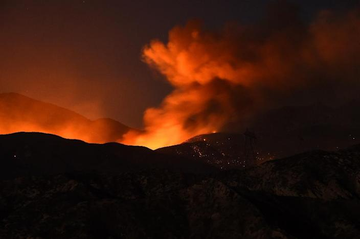More than 34,500 homes were threatened and 82,640 people were under evacuation warnings as firenadoes -- tornado-like flaming vortexes -- rage in California (AFP Photo/Robyn Beck)