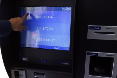 Romania's first bitcoin ATM is seen in downtown Bucharest June 27, 2014.REUTERS/Bogdan Cristel