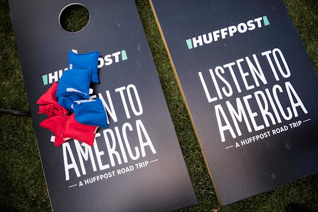 A game of cornhole sits at the HuffPostactivation site.