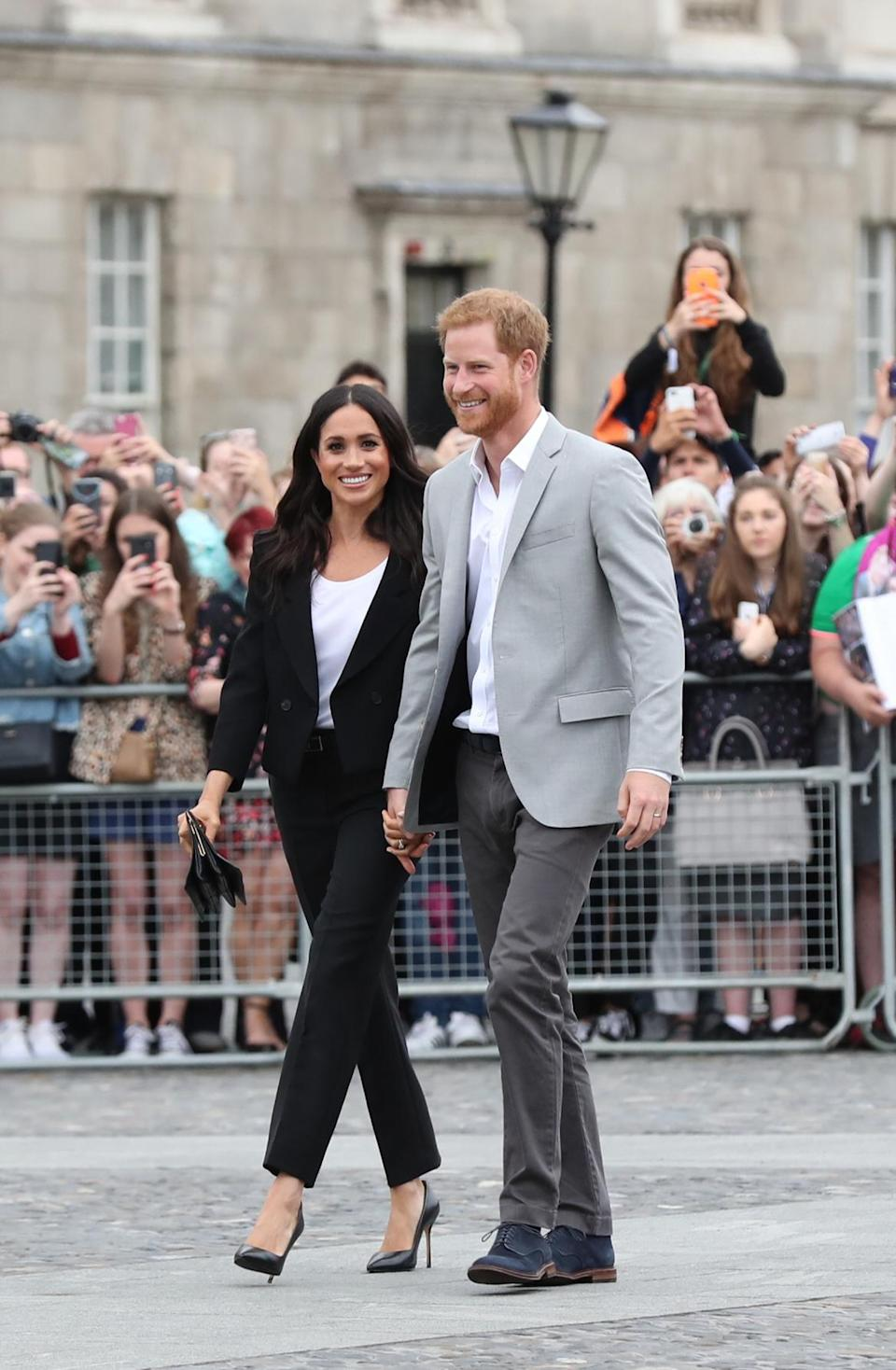 The Duchess of Sussex later changed into a slick two-piece suit by Givenchy and Sarah Flint heels [Photo: PA]