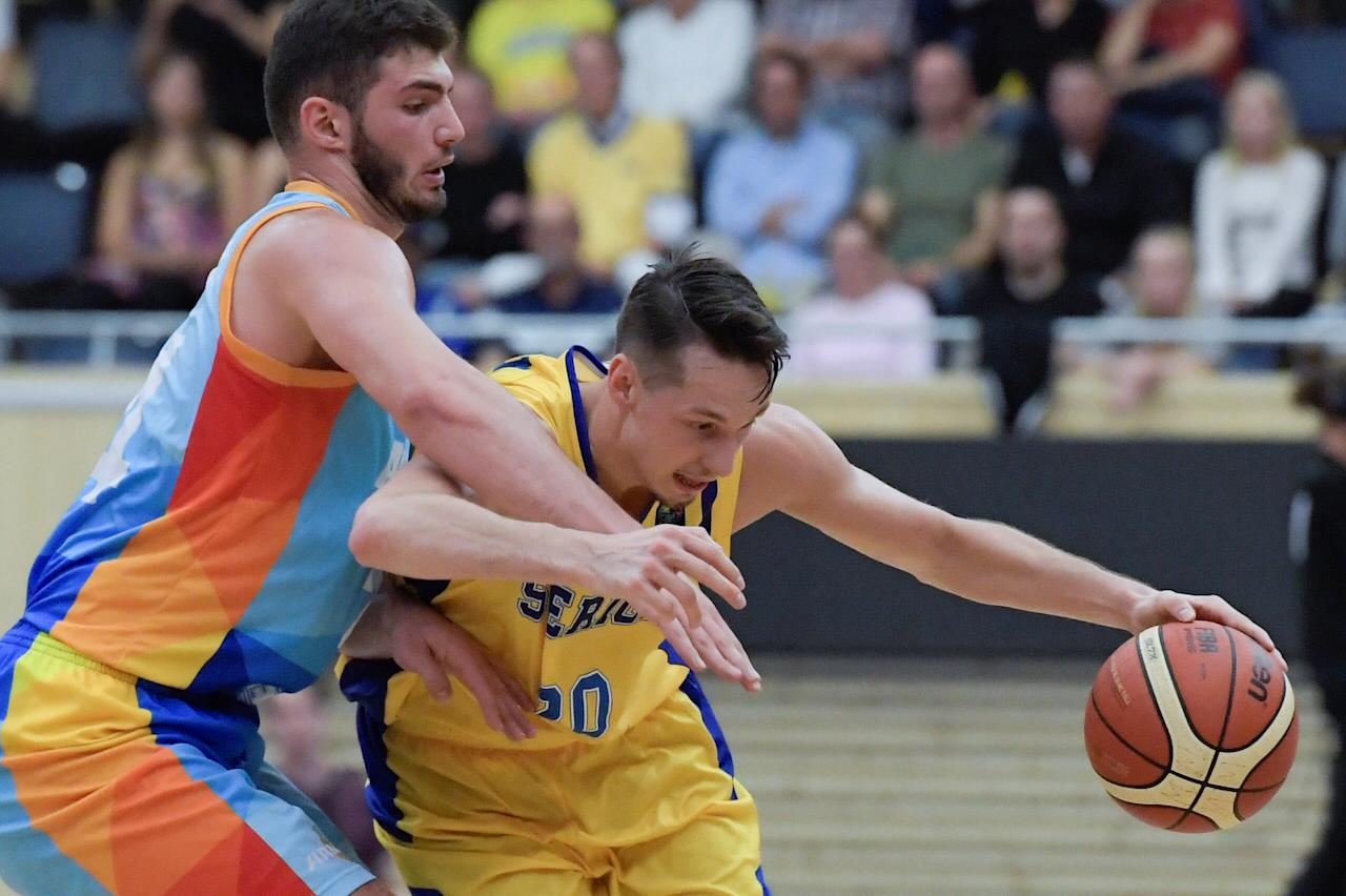 Armenia's Artem Tavakalyan chases Sweden's Marcus Eriksson during the European basketball Pre-Qualifers Group A between Sweden and Armenia at IFU Arena in Uppsala, Sweden August 16, 2017. TT News Agency/Photo Janerik Henriksson/via REUTERS ATTENTION EDITORS - THIS IMAGE WAS PROVIDED BY A THIRD PARTY. SWEDEN OUT. NO COMMERCIAL OR EDITORIAL SALES IN SWEDEN.
