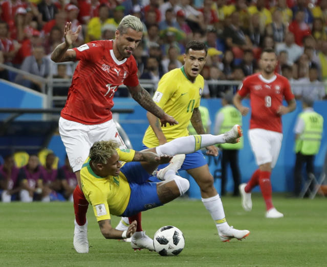 Switzerland's Valon Behrami, left, and Brazil's Neymar challenge for the ball during the group E match between Brazil and Switzerland at the 2018 soccer World Cup in the Rostov Arena in Rostov-on-Don, Russia, Sunday, June 17, 2018. (AP Photo/Themba Hadebe)