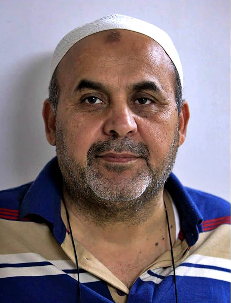 This Jan. 2014 shows Khodeir Majid. Majid, who covered Iraq's numerous conflicts as a video producer and cameraman for the Associated Press over 17 years has died at the age of 64. Relatives said the cause of his death on Friday, April 16, 2021 was complications due to the coronavirus.(AP Photo/Karim Kadim)