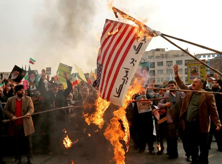 Iranian pro-government demonstrators burn makeshift US flags at a recent rally in Tehran (AFP Photo/ATTA KENARE)