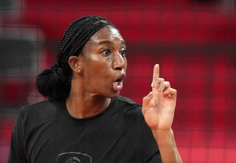 United States' Foluke Akinradewo Gunderson gestures during a women's volleyball training session at the 2020 Summer Olympics, Thursday, July 22, 2021, in Tokyo, Japan. A third trip to the Olympics was far from a sure thing for Gunderson when she gave birth to her first son in November 2019. But Gunderson had set a goal of being both a mother and professional athlete and took advantage of the delayed Olympics to make it back again this year in search of that elusive gold medal. (AP Photo/Frank Augstein)