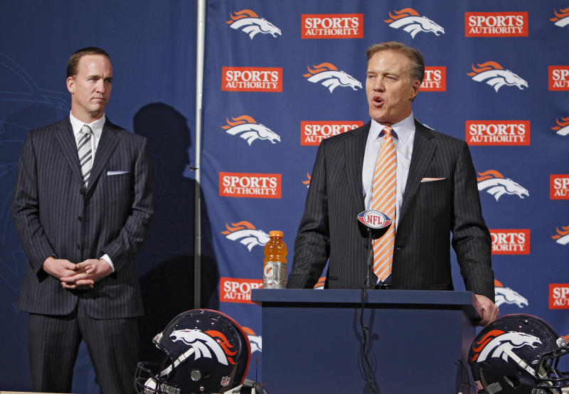 Denver Broncos vice president John Elway, right, introduces new Broncos quarterback Peyton Manning during a news conference at the NFL Denver Broncos headquarters in Englewood, Colo.,  on Tuesday, March 20, 2012.  (AP Photo/Ed Andrieski)